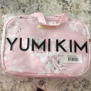 Yumi Kim hanging train case